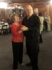President Sharyn Close and her husband, Jerry, show off a few dance moves