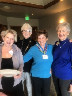 Diane Sproat, Marcia McIntyre, Wilma Hamilton and Ann Grossman share a smile in the buffet line