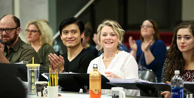 """During a reading for """"Mamma Mia!"""" at The 5th Avenue: Paolo Montalban, who stars as Sam Carmichael, and Kendra Kassebaum, who stars as Donna Sheridan (Photo by Jeff Carpenter) on equality365.com"""