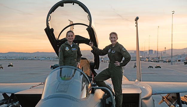 """Brie Larson (left) gets hands-on help from Brigadier General Jeannie Leavitt, 57th Wing Commander (right), on a recent trip to Nellis Air Force Base in Nevada to research her character, Carol Danvers aka Captain Marvel, for Marvel Studios' Captain Marvel. Brie Larson (left) gets hands-on help from Brigadier General Jeannie Leavitt, 57th Wing Commander (right), on a recent trip to Nellis Air Force Base in Nevada to research her character, Carol Danvers aka Captain Marvel, for Marvel Studios' """"Captain Marvel."""" Photo: Brad Baruh ©Marvel Studios 2019"""