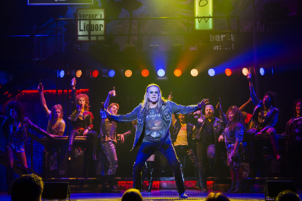 Rock legend Mickey Thomas (center) as Dennis and the cast of Rock of Ages at The 5th Avenue Theatre  (Photo Credit Tracy Martin)
