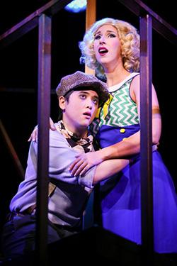 Mikko Juan as Bobby Strong and Sarah Rose Davis as Hope Cladwell in Urinetown (Photo Credit Jeff Carpenter)