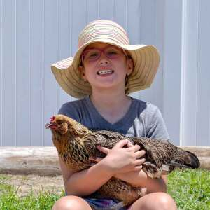 Barnyard Camp - Girl with Chicken