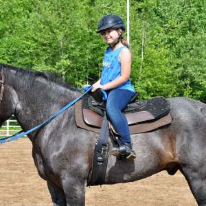 Winter Horse Camps at Kraus Farms - Girl on standing horse