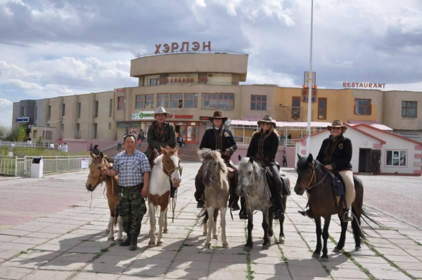 Riders preparing horses in Baganuur for the Gobi Gallop