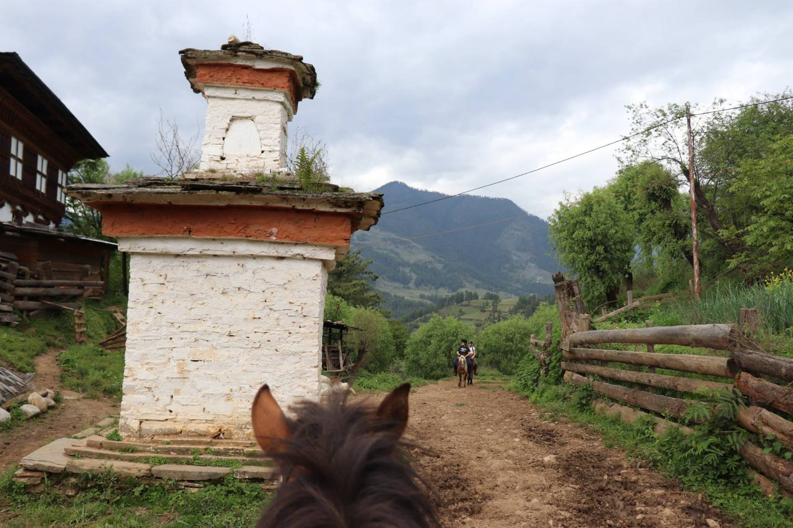 A stupa in the himalayan mountains seen while horse riding in Bhutan