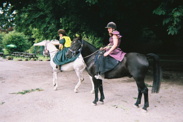 Leaving a pub to ride horses in dresses