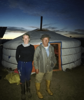 """A mongolian """"grandpa"""" posing with hinke during the mongol derby when she spent the night between horse stations."""
