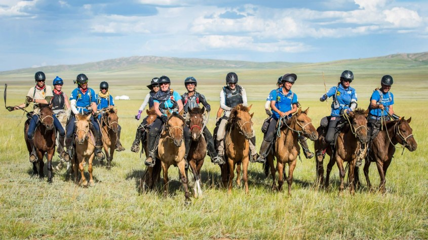 A large group of riders finishing last together during the 2014 mongol derby