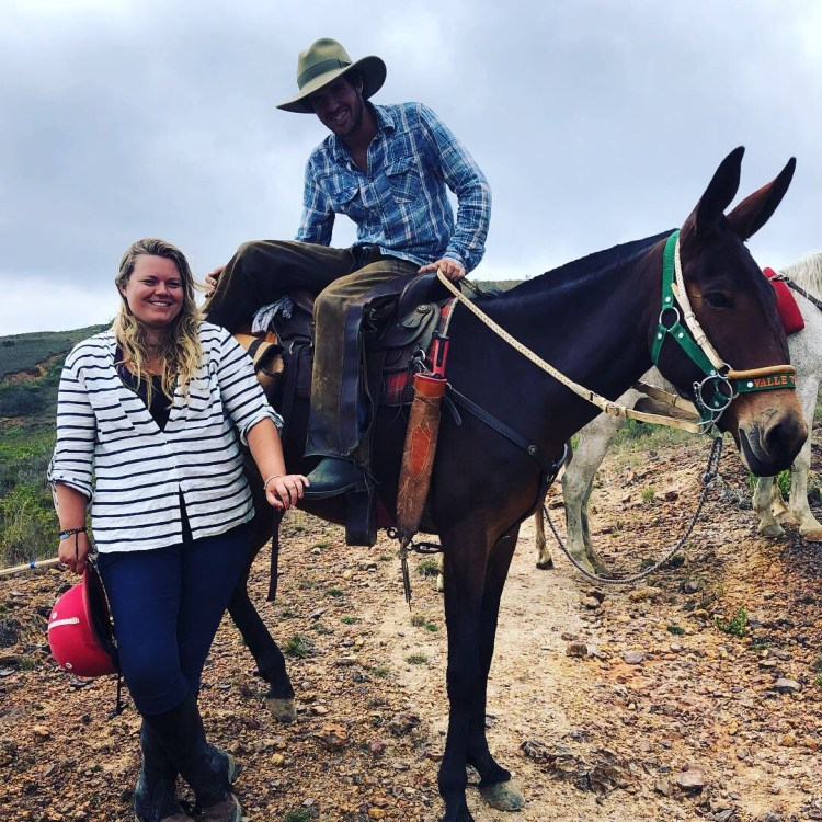 Our guide and true caballero showing the mule to me
