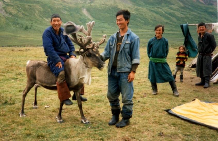the reindeer herders in Mongolia ride their reindeer