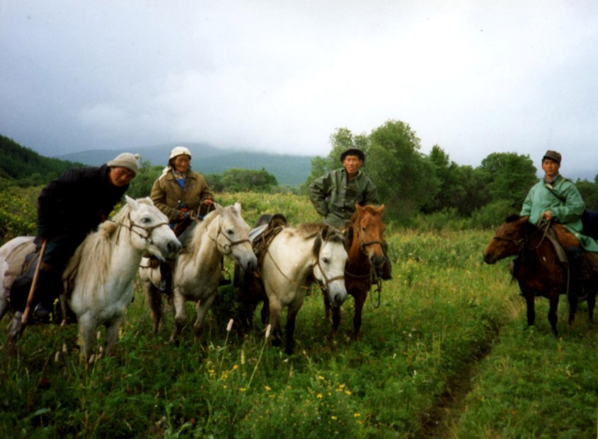 herders on their horses in the Mongolian Taiga