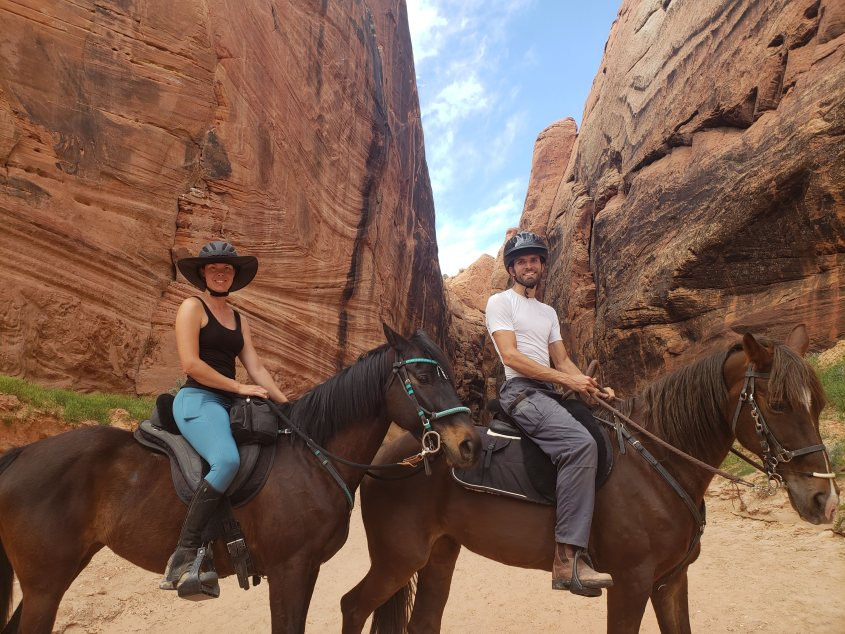 two riders at the entry to the buckskin Gulch slot canyon in Utah while horse riding across the USA