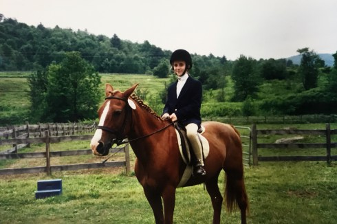 Young Caitlin dressed up and ready to ride a dressage test.