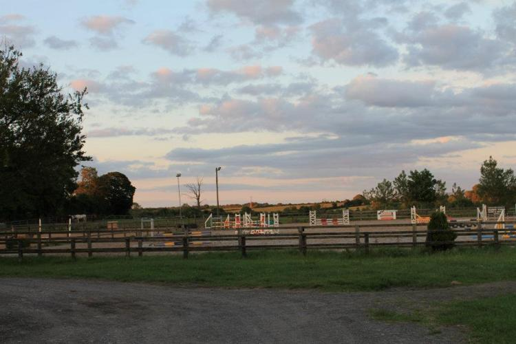 The outdoor jumping arena in the beautiful setting of the green fields of Clare in Ireland