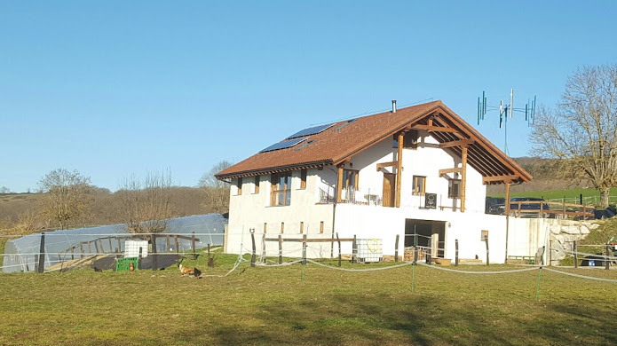 The new house with solar and wind energy generators. Also there are chicken to make our off-grid life with horses in Spain possible.