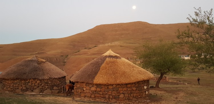 Rondavels, the traditional dwellings, in a village are a typical sight in Lesotho.