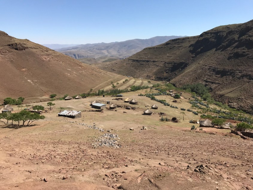 Overlooking a village in Lesotho with a couple of the traditional rondavels