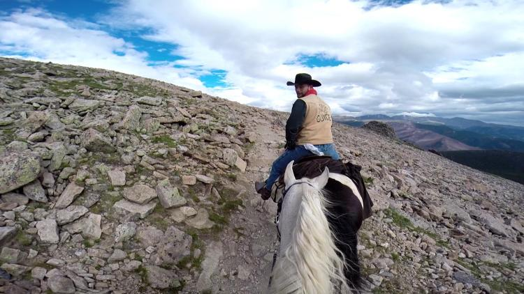Riding on a horse in the tundra up in the Rocky Mountains as part of the Continental Divide Trail in Colorado.
