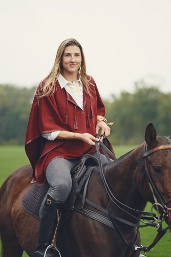 Woman Polo Players wearing a leather trim alpaca poncho