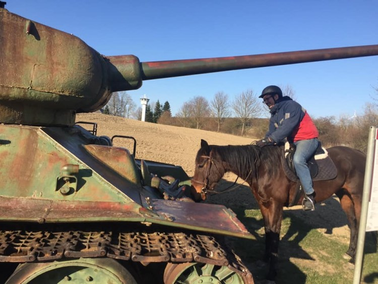 While horse riding in Germany at the museum in Mödlareuth, we try to get our horses used to a old Russian tank