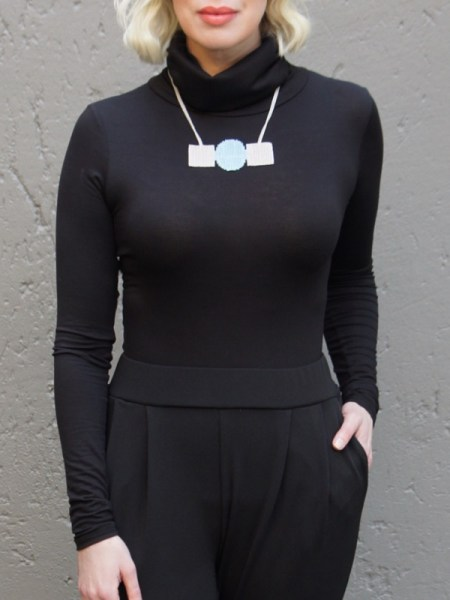 Zulu love letter white and blue beads on model with polo neck South Africa