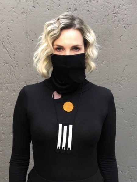 Woman wearing black polo neck with built-in face mask South Africa