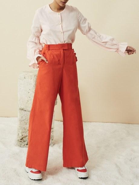 Orange high waisted wide leg hemp pants with pink hemp blouse
