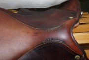 Saddle seat with stitched repair
