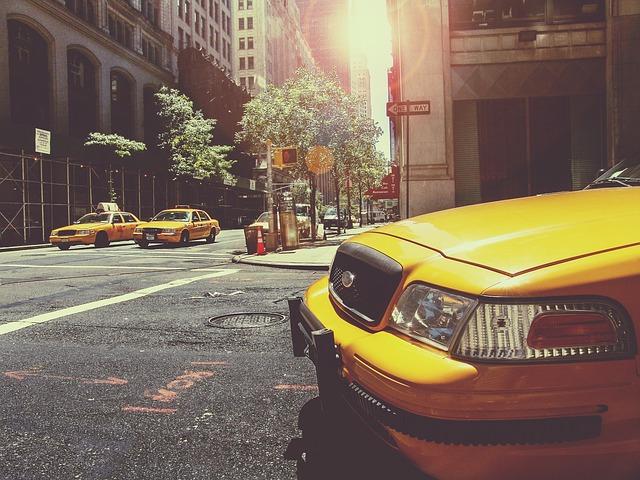 yellow car in road street