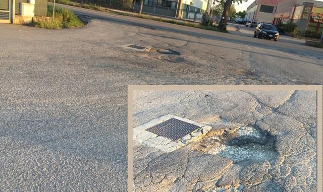 buca sul manto stradale risarcimento