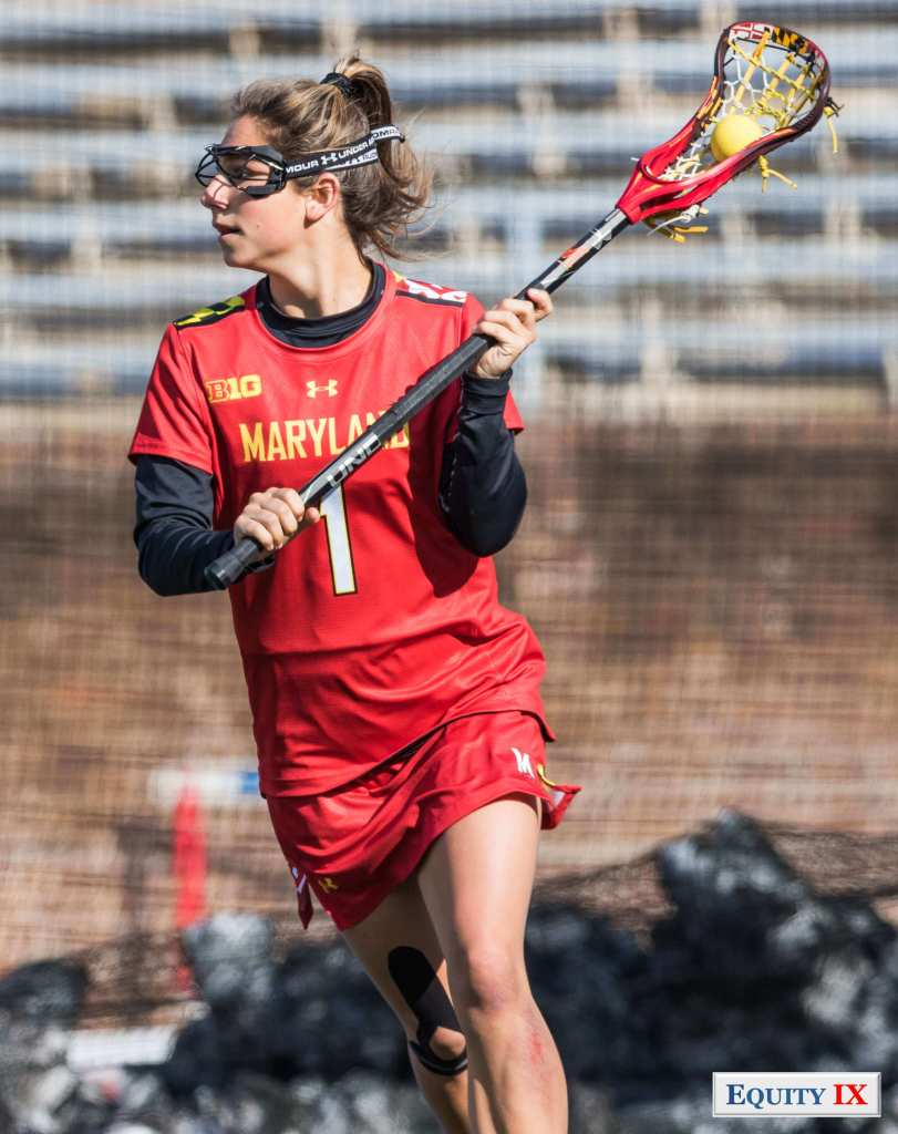 #1 Brindi Griffin cradles the lacrosse ball left handed looking to pass for Maryland - NCAA Women's Lacrosse © Equity IX - SportsOgram - Leigh Ernst Frietedt