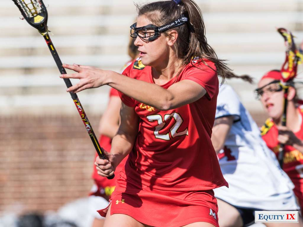 #22 Grace Griffin top Freshman for Maryland plays defense with black lacrosse stick wearing a bright red Maryland jersey and goggles - 2018 NCAA Women's Lacrosse © Equity IX - SportsOgram - Leigh Ernst Friestedt
