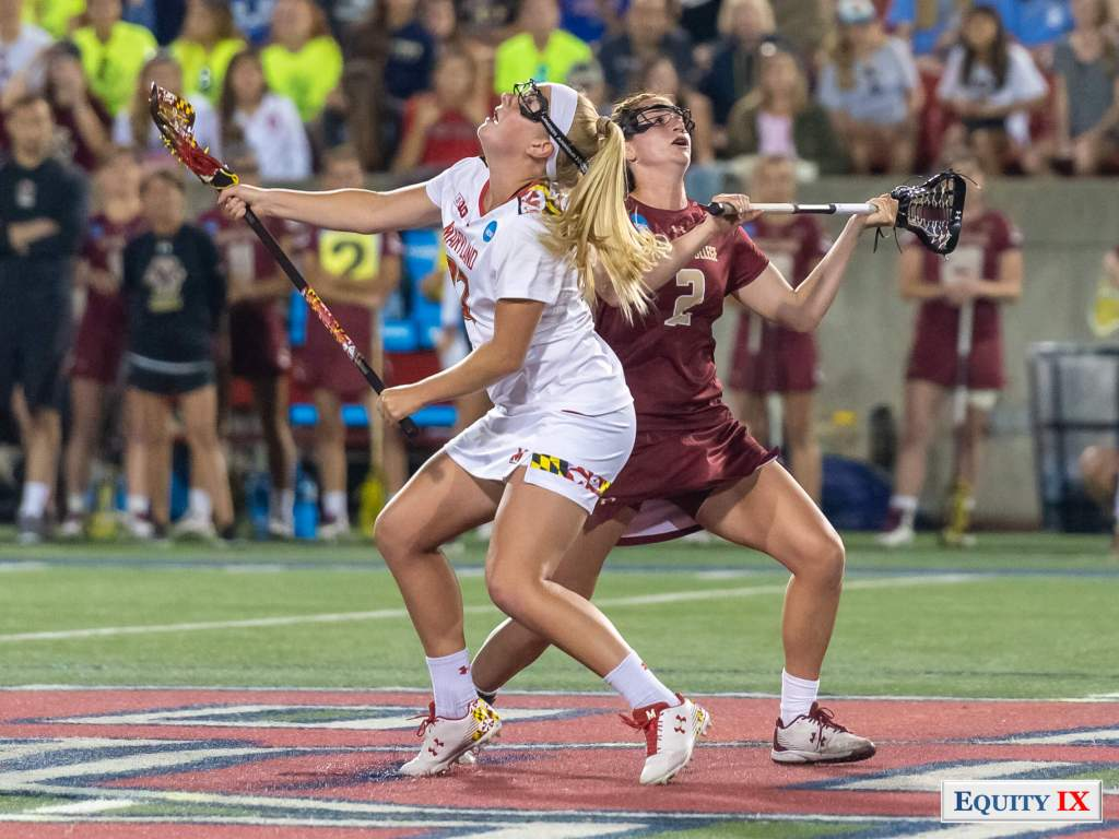 Meghan Siverson (#37 Maryland) draws against Sam Apuzzo (#2 Boston College) both lacrosse sticks to the side with heads looking up wearing goggles - 2018 NCAA Women's Lacrosse Final Four © Equity IX - SportsOgram - Leigh Ernst Friestedt
