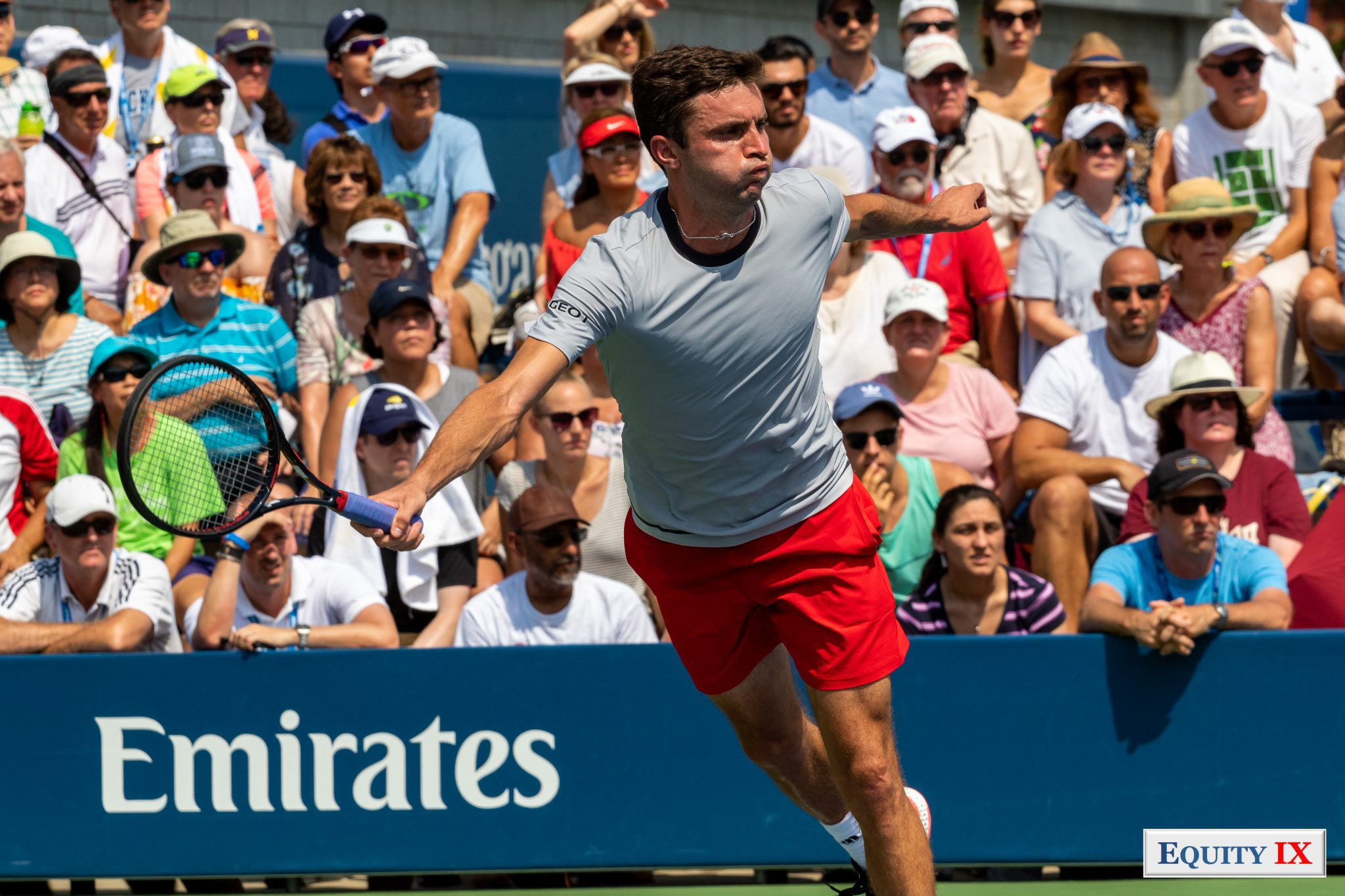 2018 US Open Tennis Championship - Gilles Simon (France) is fully stretched out on a return of serve on the forehand side with air in his cheeks before he breathes out to hit the ball in very shirt and red Adidas shorts © Equity IX - SportsOgram - Leigh Ernst Friestedt
