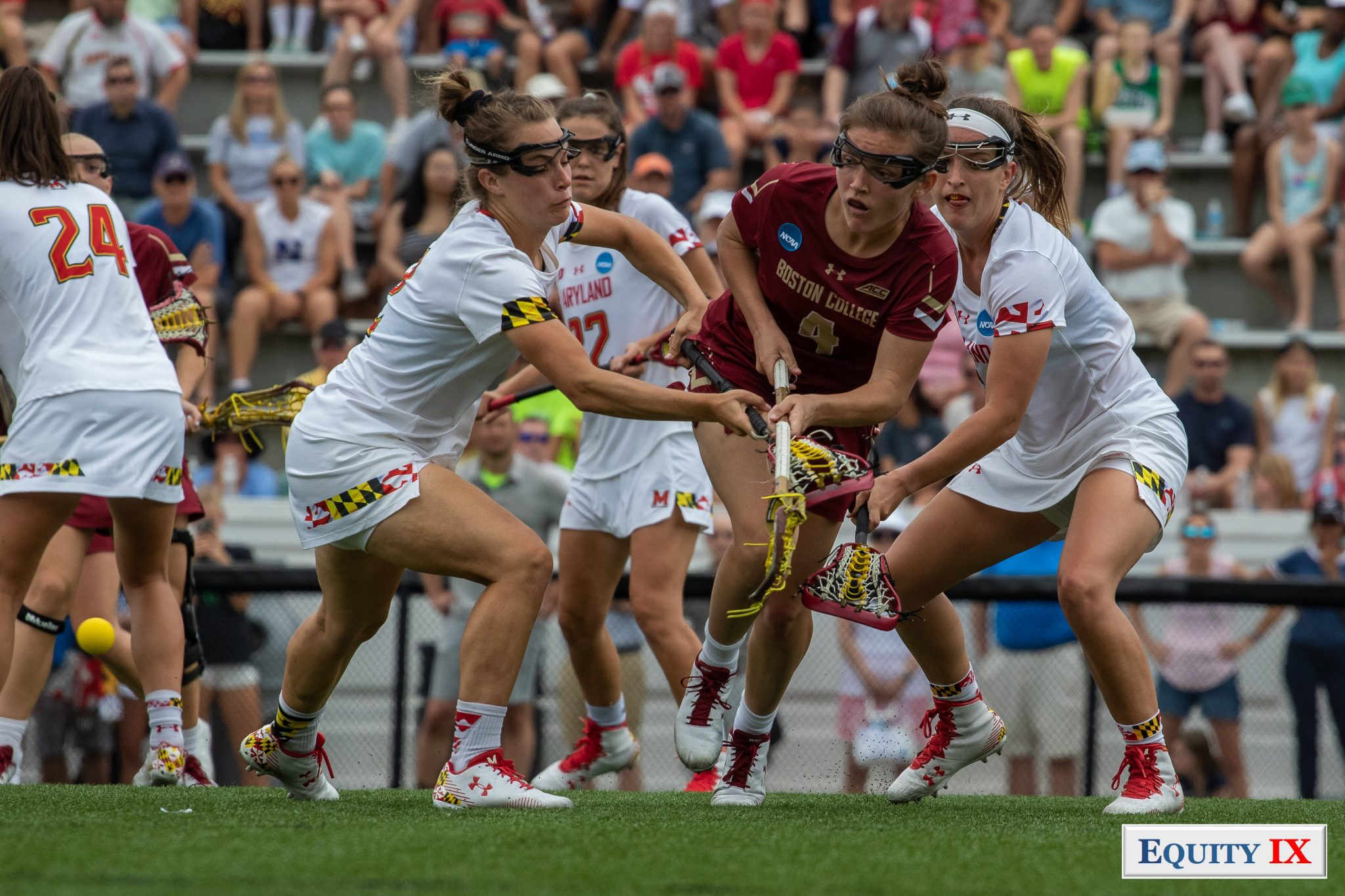 Kenzie Kent shoots left handed between two Maryland defenders at 2019 NCAA Women's Lacrosse Championship Game © Equity IX - SportsOgram - Leigh Ernst Friestedt