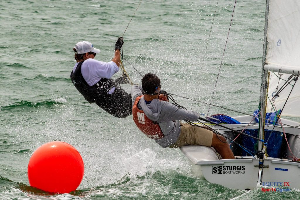 TBO skippers 420 sailboat around orange marker in the ocean with crew hiking out over the waves and spray hitting the sailors in the face - 2019 Nantucket Yacht Club © Equity IX - SportsOgram - Leigh Ernst Friestedt