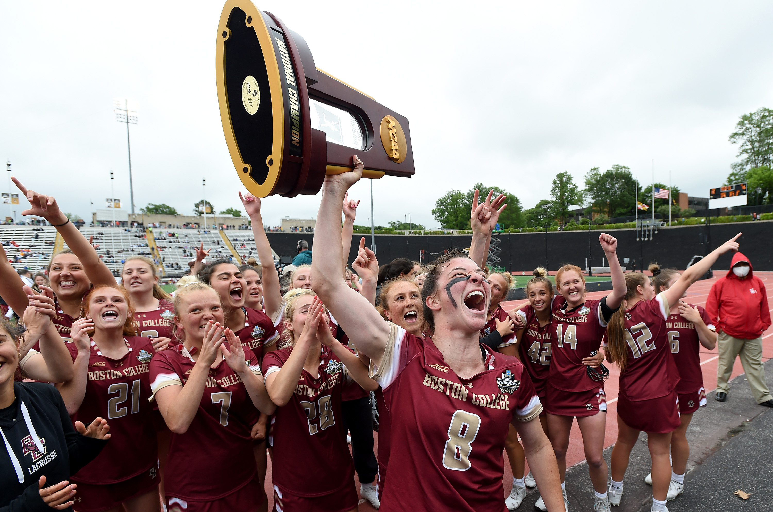 #8 Charlotte North and Boston College team celebrate winning 2021 NCAA Women's Lacrosse Championship raising the NCAA National Champions trophy n the air to share with fans