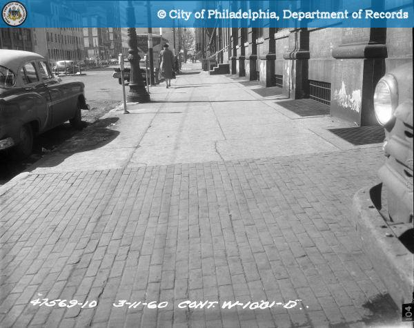 Cont. W-1001-D - Spring Garden Street-North Side - 13th Street to 12th Street: Sidewalk 1217-1233 Spring Graden Street, 60' West of Driveway.