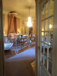 De slaapkamer van de barones.