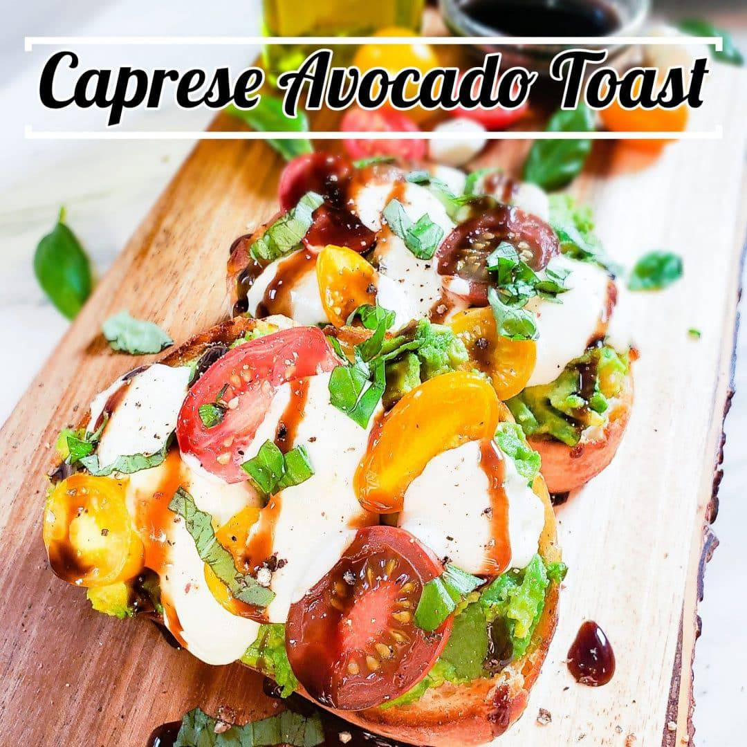 """The pin for Caprese Avocado Toast. The toast have mashed avocado, tomatoes, basil ribbons, mozzarella and balsamic glaze on top. In the background faded out is olive oil, tomatoes, and a small bowl of glaze. In black cursive writing on top is the words, """"Caprese Avocado Toast""""."""