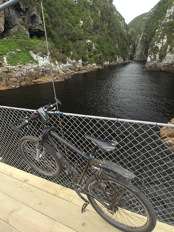 Storm river mouth with bike on the suspension bridge trail