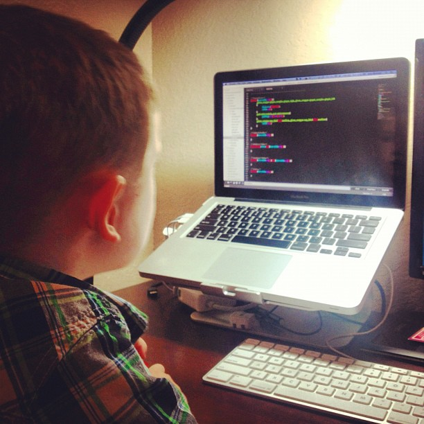 My kid sits in my lap as i program. Your kid should be afraid ;)