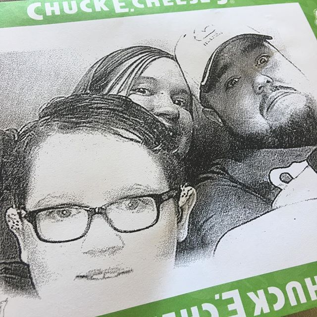 Family picture at Chuck E Cheese's.