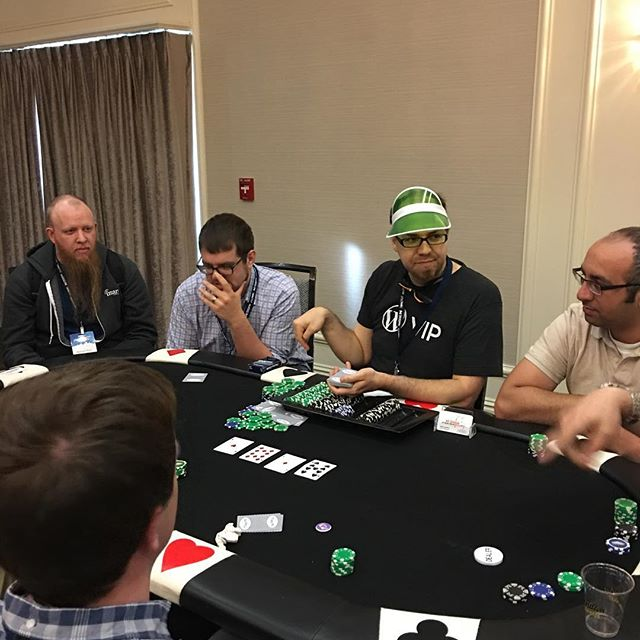 Stèphane dealing the poker table at #phptek