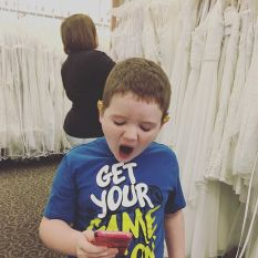 Snapchatting while mom looks at dresses. #letmetakeaselfie