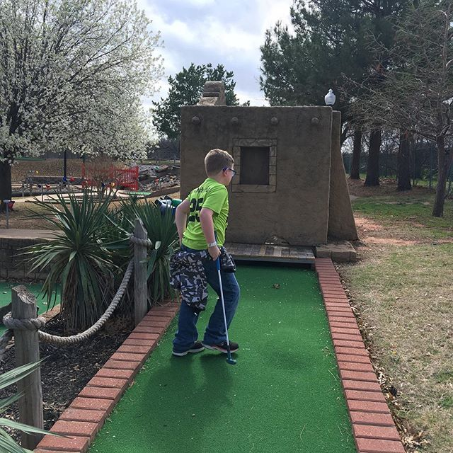 Hero playing putt-putt.