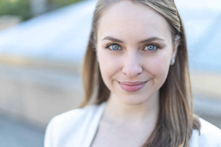 A close up photo of a woman with striking blue eyes.