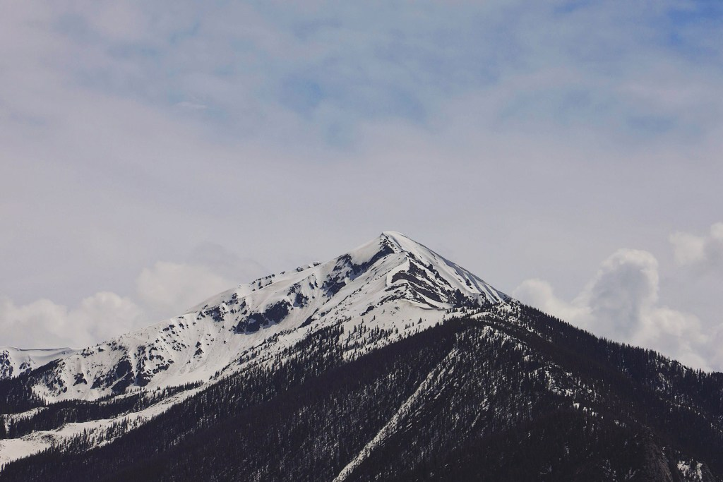 A photo of a snow capped mountain.