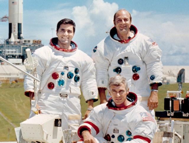 Apollo 17 lunar landing mission are: Commander, Eugene A. Cernan (seated), Command Module pilot Ronald E. Evans (standing on right), and Lunar Module pilot, Harrison H. Schmitt.